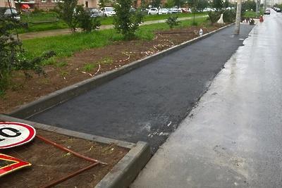 Новые парковочные места и пешеходные дорожки сделали в микрорайоне Кузнечики Подольска